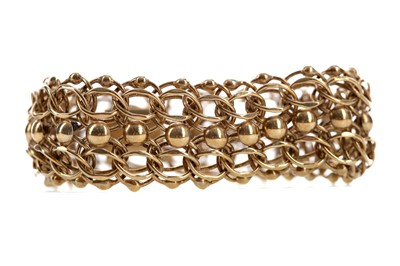 Lot 523 - A GOLD BRACELET WITH BEAD DECORATION