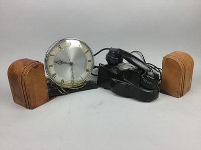 Lot 22 - AN EARLY 20TH CENTURY BAKELITE TELEPHONE, LEATHER BOOKENDS AND A MANTEL CLOCK