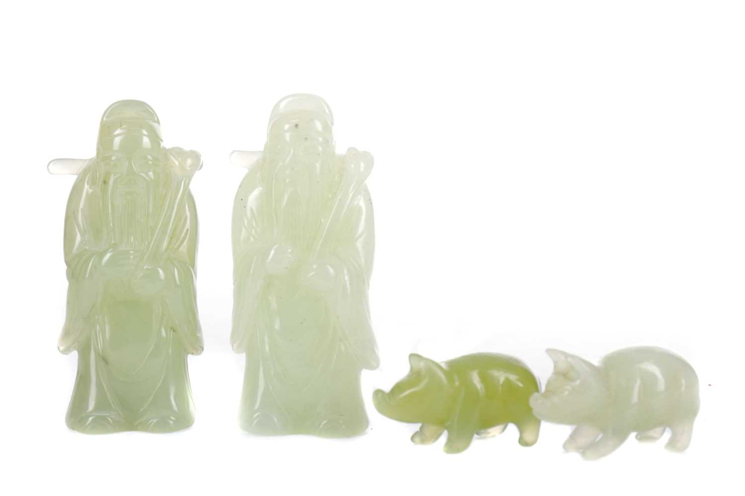 Lot 724 - A LOT OF TWO 20TH CENTURY CHINESE GREEN HARDSTONE FIGURES AND TWO PIGS