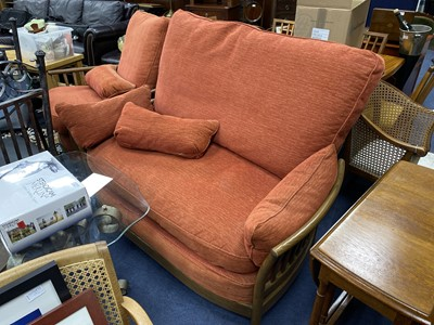 Lot 58 - AN ERCOL SETTEE AND MATCHING ARMCHAIR