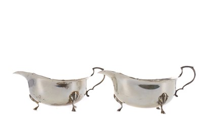 Lot 434 - A PAIR OF ELIZABETH II SILVER SAUCEBOATS