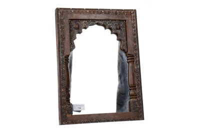 Lot 738 - A MOORISH CARVED WOOD FRAMED MIRROR AND A PLATED FLORAL PLAQUE