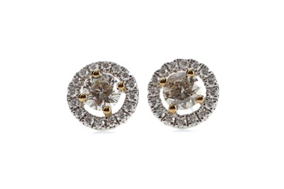 Lot 825 - A PAIR OF YELLOW DIAMOND STUD EARRINGS