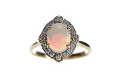 Lot 532 - AN OPAL AND DIAMOND RING