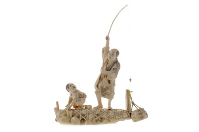 Lot 911 - A JAPANESE IVORY CARVING OF A FISHERMAN AND BOY