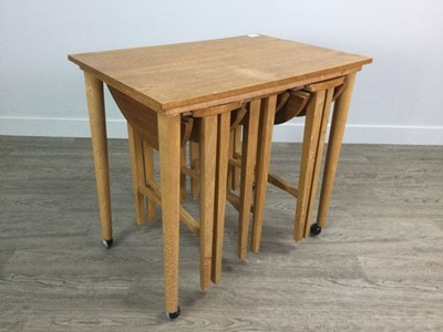 Lot 1642 - A SET OF FOUR TEAK MORPHIC DROP LEAF NESTING TABLES BY POUL HUNDEVAD