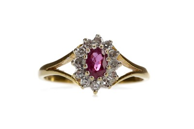 Lot 1310 - A RUBY AND DIAMOND CLUSTER RING