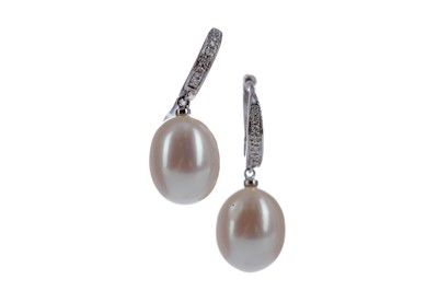 Lot 1317 - A PAIR OF PEARL AND DIAMOND EARRINGS