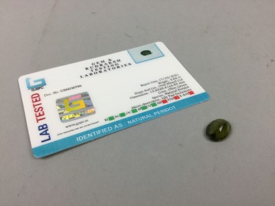 Lot 60A - **CERTIFICATED UNMOUNTED PERIDOT, oval mixed...
