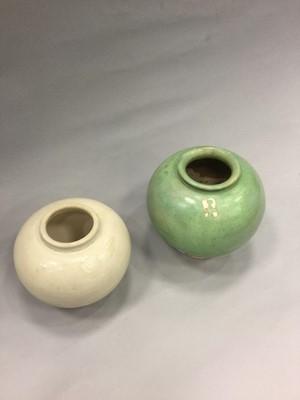 Lot 728 - A CHINESE GREEN GLAZED POTTERY JAR AND A STRAW GLAZED JAR