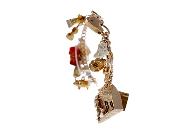 Lot 1366 - GOLD CHARM BRACELET