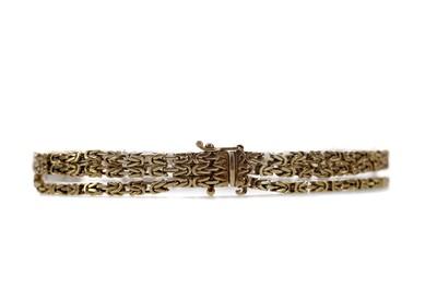 Lot 1386 - A GOLD THREE STRAND BRACELET