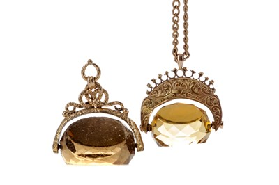 Lot 1411 - TWO SWIVEL FOBS AND A ROLLED GOLD CHAIN