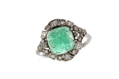 Lot 1373 - CARVED EMERALD AND DIAMOND RING
