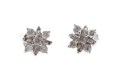 Lot 1475 - A PAIR OF DIAMOND CLUSTER EARRINGS