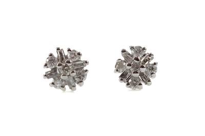 Lot 1418 - A PAIR OF DIAMOND STUD EARRINGS