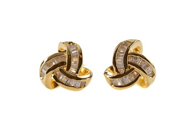 Lot 1341 - A PAIR OF DIAMOND KNOT EARRINGS