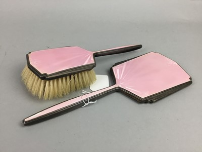 Lot 2 - AN ART DECO SILVER AND PINK GUILLOCHE ENAMEL VANITY MIRROR AND BRUSH AND A CLOCK