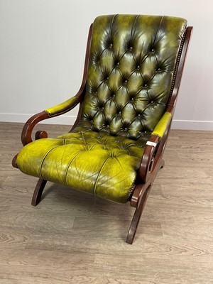 Lot 1309 - A GREEN LEATHER BUTTON BACK LIBRARY ARMCHAIR