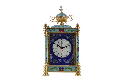 Lot 1101 - A REPRODUCTION ORMOLU AND CHAMPLEVE ENAMEL MANTEL CLOCK