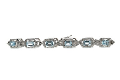 Lot 331 - A TOPAZ AND DIAMOND BRACELET