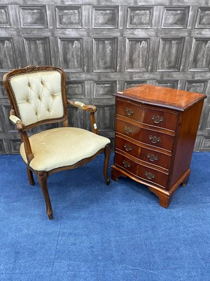 Lot 77 - A REPRODUCTION STAINED WOOD CHEST OF DRAWERS AND AN ELBOW CHAIR