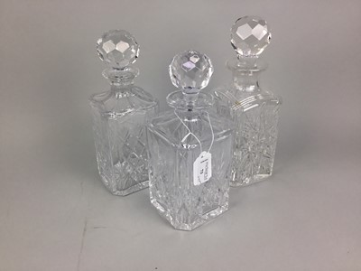 Lot 73 - A LOT OF THREE CRYSTAL DECANTERS WITH STOPPERS AND OTHER CRYSTAL WARE