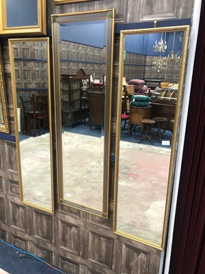 Lot 83 - A PAIR OF GILT FRAMED NARROW UPRIGHT WALL MIRRORS AND ANOTHER MIRROR