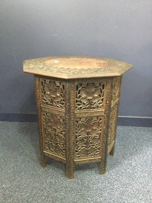 Lot 727 - AN INDIAN CARVED WOOD FOLDING TABLE