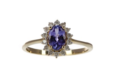 Lot 381 - A TANZANITE AND DIAMOND RING