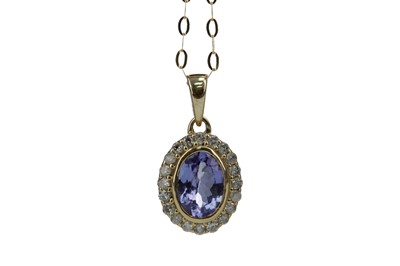 Lot 386 - A TANZANITE AND DIAMOND PENDANT
