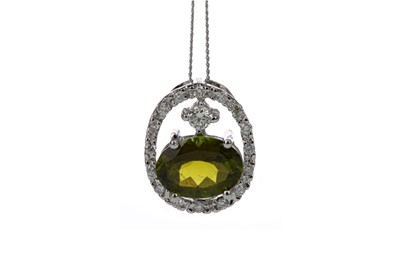 Lot 434 - A TOURMALINE AND DIAMOND PENDANT