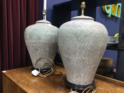 Lot 20 - A LARGE PAIR OF ARCHAIC STYLE LAMPS