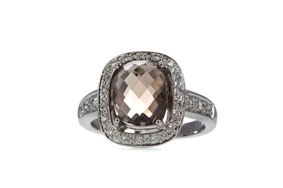 Lot 414 - A SMOKY QUARTZ AND DIAMOND RING