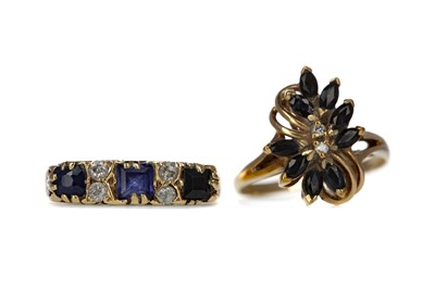 Lot 441 - TWO BLUE GEM SET AND DIAMOND RINGS