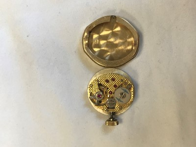 Lot 718 - A LADY'S ROTARY NINE CARAT GOLD WRIST WATCH AND PIN