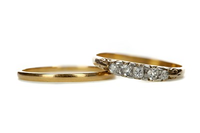 Lot 804 - A DIAMOND FIVE STONE RING AND A WEDDING BAND