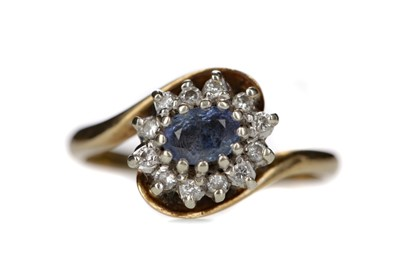Lot 806 - A BLUE GEM SET AND DIAMOND RING