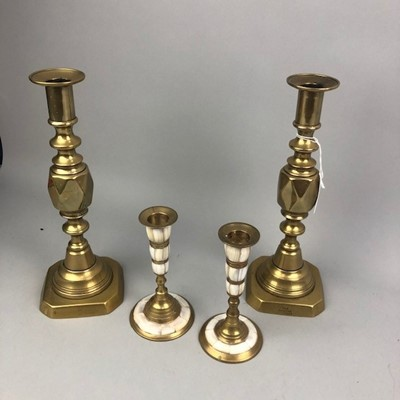 Lot 47 - A PAIR OF BRASS 'THE DIAMOND PRINCESS' CANDLESTICKS AND ANOTHER PAIR OF CANDLESTICKS