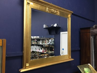 Lot 12 - A REPRODUCTION GILT FRAMED OVER MANTEL MIRROR