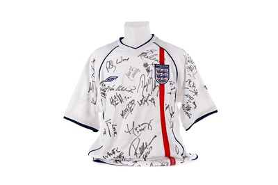 Lot 1721 - AN ENGLAND INTERNATIONAL JERSEY SIGNED T.V. AND MUSIC PERSONALITIES