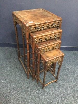 Lot 722 - A CHINESE NEST OF FOUR TABLES