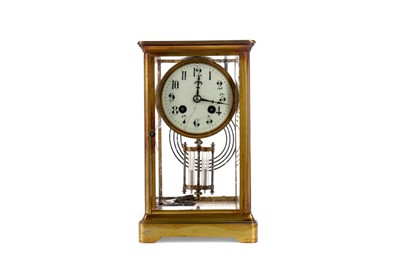 Lot 1139 - AN EDWARDIAN BRASS MANTEL CLOCK