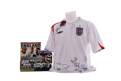 Lot 1724 - AN ENGLAND INTERNATIONAL JERSEY SIGNED BY THE TEAM, ALONG WITH RELATED EPHEMERA