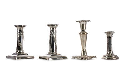 Lot 435 - AN EDWARDIAN SILVER CANDLESTICK AND THREE OTHERS