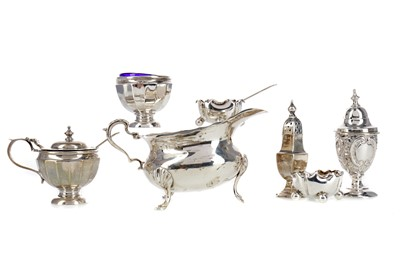 Lot 438 - AN EDWARDIAN SILVER CREAM JUG ALONG WITH CONDIMENTS