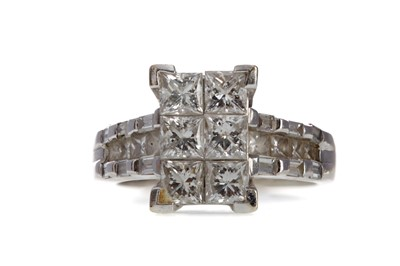 Lot 864 - AN  ILLUSION SET DIAMOND DRESS RING