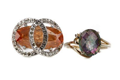 Lot 851 - AN ORANGE GEM SET AND A MYSTIC TOPAZ RING