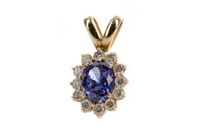 Lot 886 - A TANZANITE AND DIAMOND CLUSTER PENDANT