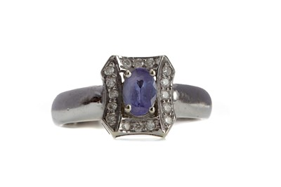Lot 871 - A TANZANITE AND DIAMOND RING